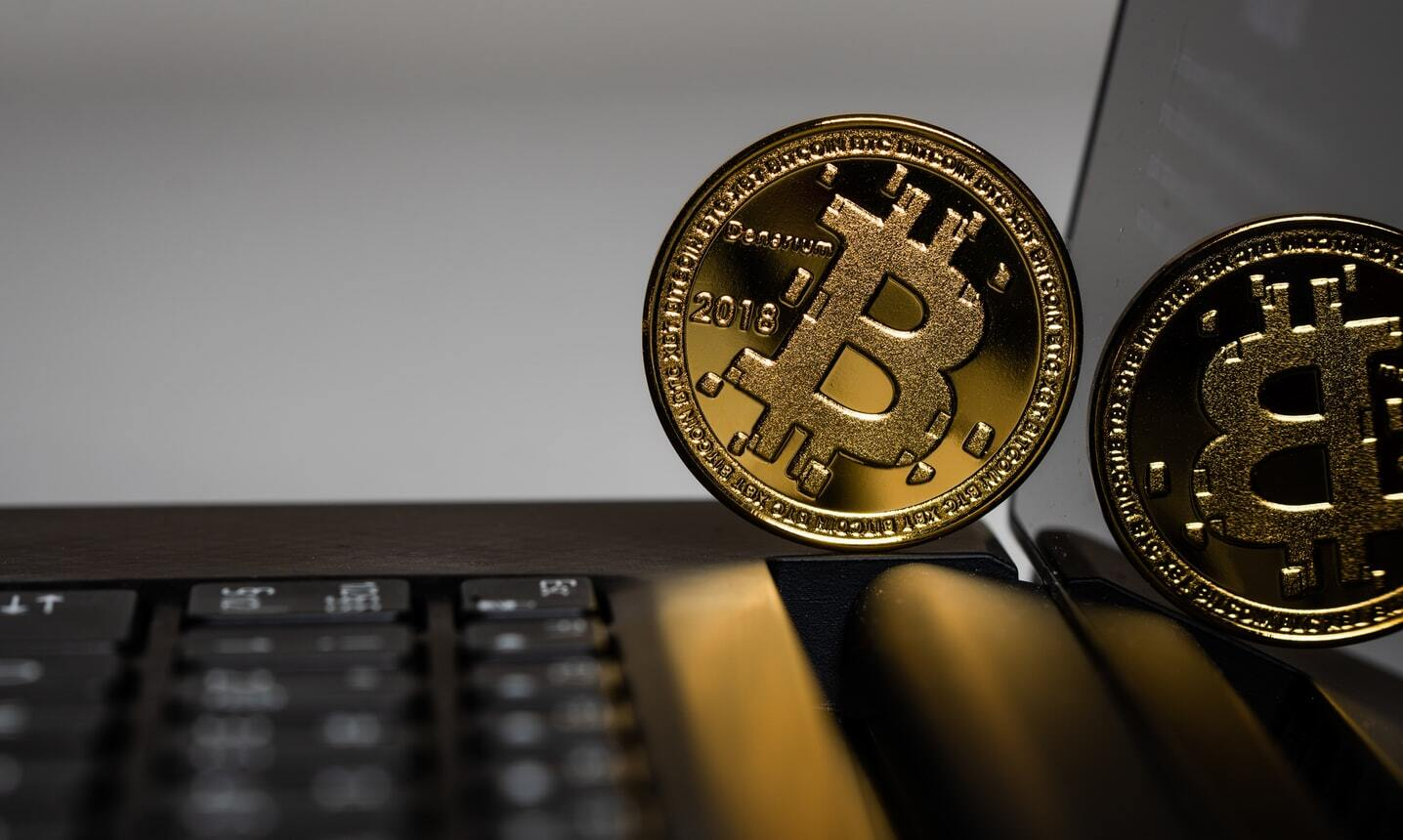bitcoin-on-laptop-keyboard-in-rotating-position-paypal-have-post